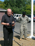 Fr. Joe O'Brien, Pastor of  Church of the Holy Spirit in East Greenbush offers a blessing, dedicating the new flagpoles at Gettysburg Flag Works to our soldiers and their families.